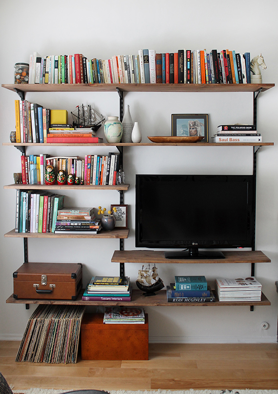 Diy mounted shelving almost makes perfect - Living room multi use shelf idea ...